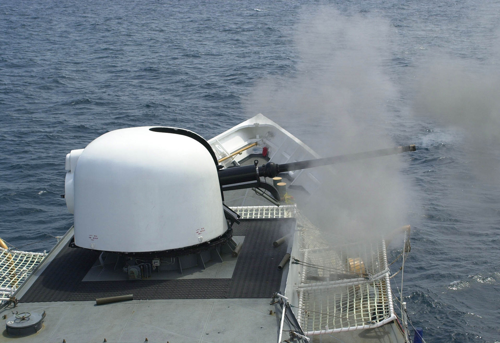 JACKSONVILLE, Fla. (Apr. 26, 2005) The 76mm gun aboard the Coast Guard Cutter Gallatin fires a three-round burst during a live-fire exercise off the coast of Mayport, Fla., April 26, 2005. The MK 75 can fire up to 80 rounds a minute and has a range of approximately 10 nautical miles. The Gallatin is a 378-foot cutter homeported in Charleston, S.C. and is in Mayport for Tailored Annual Cutter Training (TACT). U.S. Coast Guard photo by PA3 Bobby Nash.